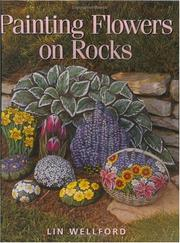Painting flowers on rocks by Lin Wellford