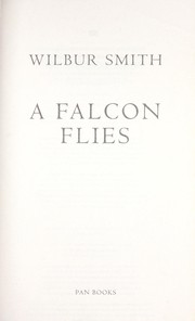 Cover of: A falcon flies