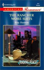 Cover of: The Rancher Wore Suits by Rita Herron